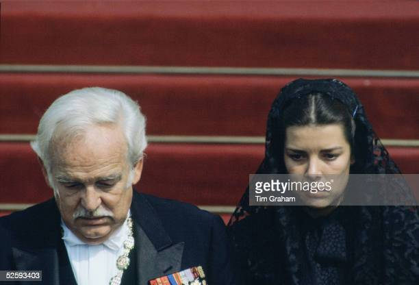Prince Rainier of Monaco accompanied by his daughter Princess Caroline wearing a black lace mantilla attending the funeral of his wife Princess Grace...
