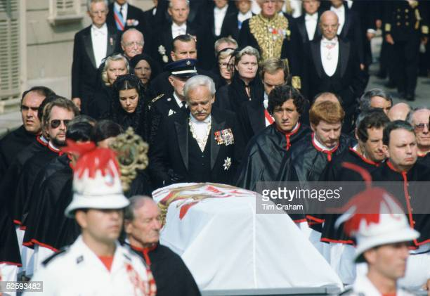 Prince Rainier of Monaco accompanied by his daughter Princess Caroline and his son Prince Albert walk behind the coffin of his wife Princess Grace at...