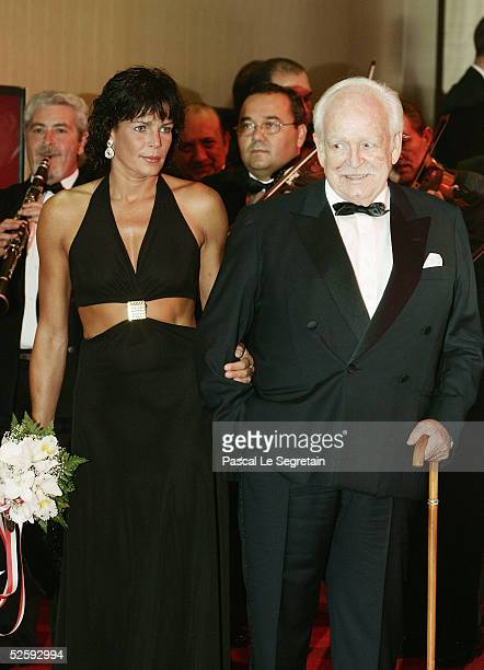 Prince Rainier of Monaco and his daughter Princess Stephanie arrive at the Monte Carlo Red Cross Ball 2004 held at the Salle des Etoiles of the...