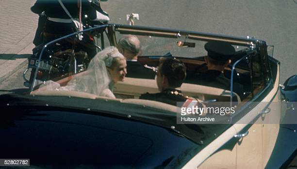 Prince Rainier of Monaco and his new bride American actress Grace Kelly leave Monaco Cathedral in an opentop car after their wedding 19th April 1956