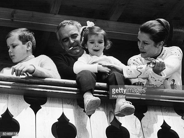 Prince Rainier of Monaco and his wife Princess Grace on the balcony of their Swiss hotel with two of their children Prince Albert and Princess...