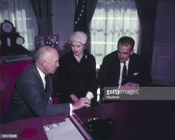 Prince Rainier of Monaco and his wife Princess Grace with US president Dwight D Eisenhower during a visit to the White House 1956