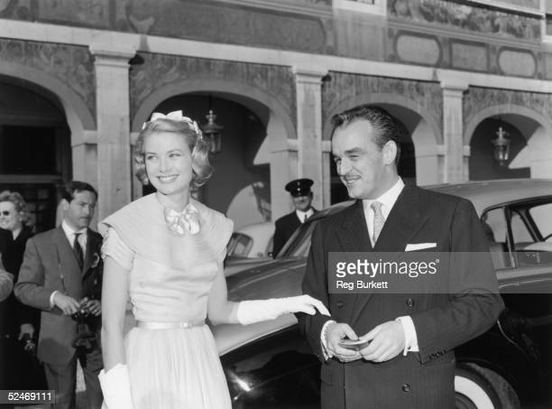 Prince Rainier of Monaco and his wife-to-be Princess Grace greet well-wishers in the palace courtyard in Monte Carlo prior to their wedding, 18th...