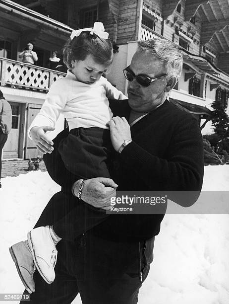 Prince Rainier of Monaco takes his threeyearold daughter Princess Stephanie for a walk in the snow during a holiday in Switzerland April 1968 The...