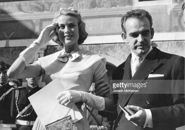 Prince Rainier of Monaco with Grace Kelly the American film actress and his future bride receiving gifts on the eve of their wedding Original...