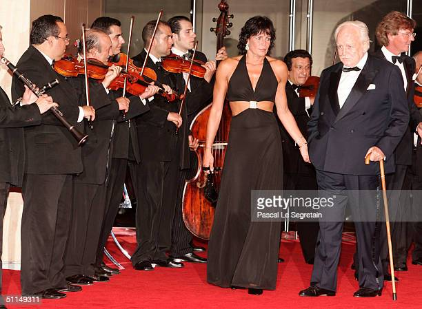 Prince Rainier of Monaco with his daughter Princess Stephanie and Prince Ernst August of Hanover arrive at the Monte Carlo Red Cross Ball 2004 held...