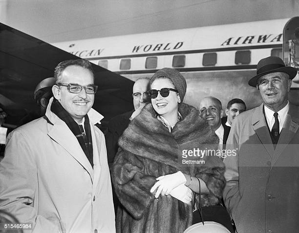 Prince Rainier stands by as Princess Grace is greeted by her father John kelly as they arrive in New York for a few weeks in New York City and...