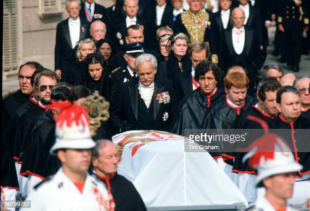 Prince Rainier with his daughter Princess Caroline and his son Prince Albert walks behind the coffin of his wife at the funeral of Princess Grace of...