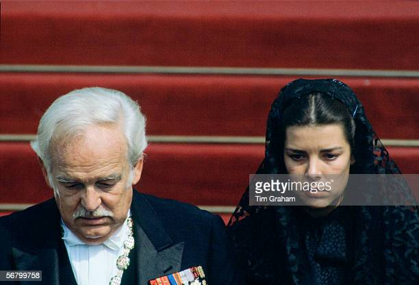 Prince Rainier with his daughter Princess Caroline wearing a black lace mantilla for the funeral of Princess Grace of Monaco