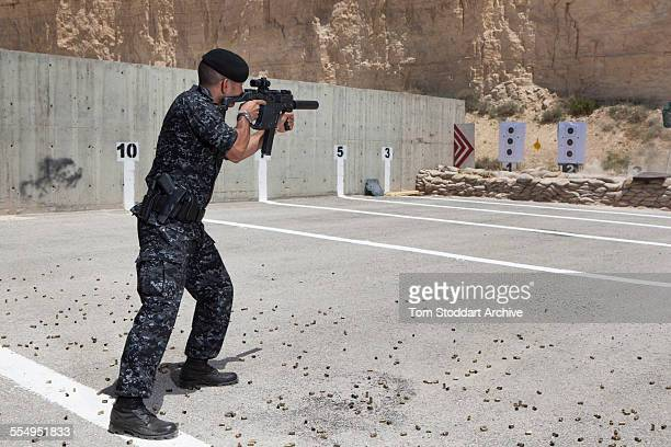 Prince Rashid bin El Hassan of Jordan tries out a weapon on a firing range during the Warrior Competition at KASOTC Prince Rashid the youngest child...