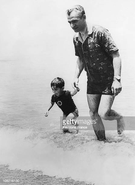 Prince Reza Pahlavi And His Father The Shah Of Iran Mohammad Reza Pahlavi During Their Holidays In NouShahr On The Caspian Sea In Iran July 8 1963