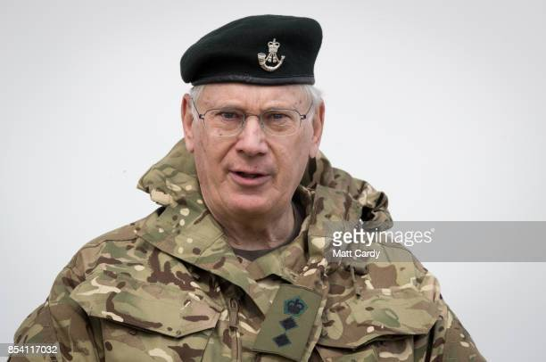 Prince Richard Duke of Gloucester watches a demonstration at a live firing point during his visit to Okehampton Camp Dartmoor during the 6th...