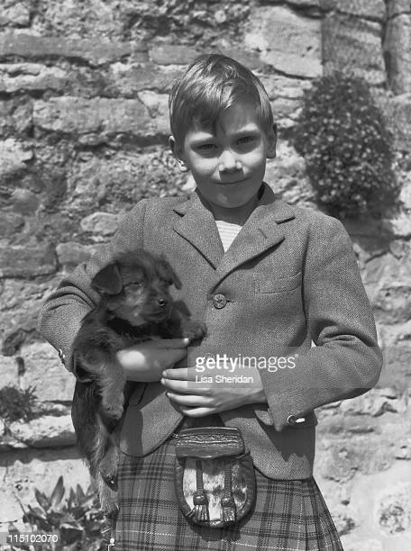 Prince Richard of Gloucester with his pet puppy at his home at Barnwell Manor, Northamptonshire in June 1952.