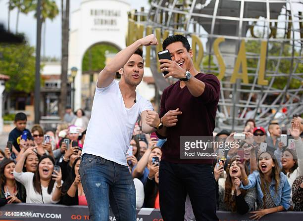 """Prince Royce and Mario Lopez visit """"Extra"""" at Universal Studios Hollywood on February 27, 2015 in Universal City, California."""