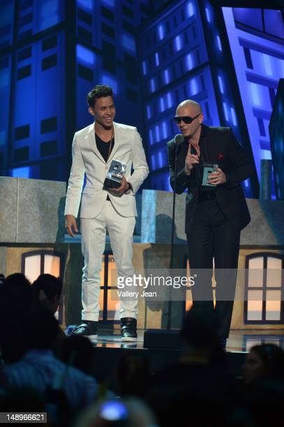 Prince Royce and Pitbull onstage during Univision's Premios Juventud Awards at Bank United Center on July 19, 2012 in Miami, Florida.