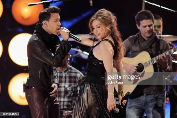 Prince Royce and Thalia perform onstage at the 25th Anniversary of Univision's Premio Lo Nuestro A La Musica Latina on February 21 2013 in Miami...