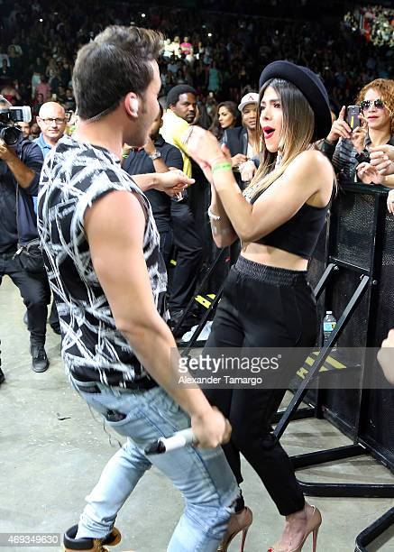 Prince Royce is seen dancing with Danella Urbay during El Nuevo Zol Miami Bash at the AmericanAirlines Arena on April 10 2015 in Miami Florida