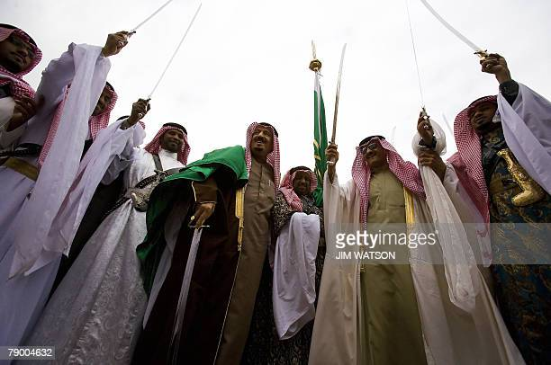 Prince Salman bin Abdul Aziz the brother of the Saudi king and Governor of Riyadh takes part in a traditional war dance as he awaits US President...