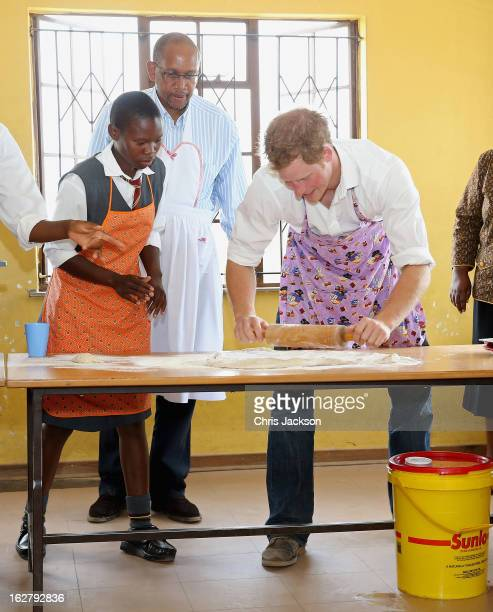 Prince Seeiso and Prince Harry cook cakes as they visit Kananelo Centre for the deaf a project supported by his charity Sentebale on February 27 2013...