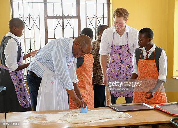 Prince Seeiso and Prince Harry cook cakes as they visit Kananelo Centre for the deaf, a project supported by his charity Sentebale on February 27,...