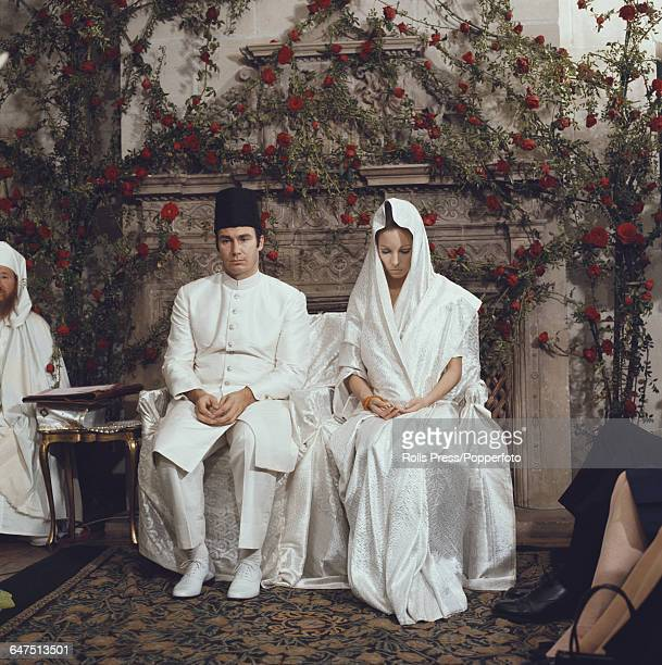 Prince Shah Karim Al Hussaini Aga Khan IV pictured together with his bride Salimah Aga Khan on their wedding day at the Aga Khan's residence in Paris...
