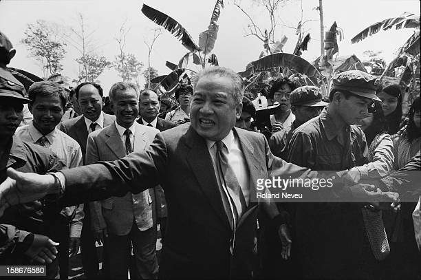Prince Sihanouk is returning to Cambodia for the first time after being forced into exile by the Khmer Rouge in 1977 He is flanked by Khmer Rouge...