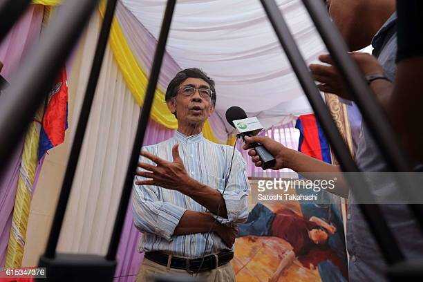 Prince Sisowath Thomico answers reporters questions during the 100day funeral ceremony for prominent political analyst Kem Ley who was shot dead at...