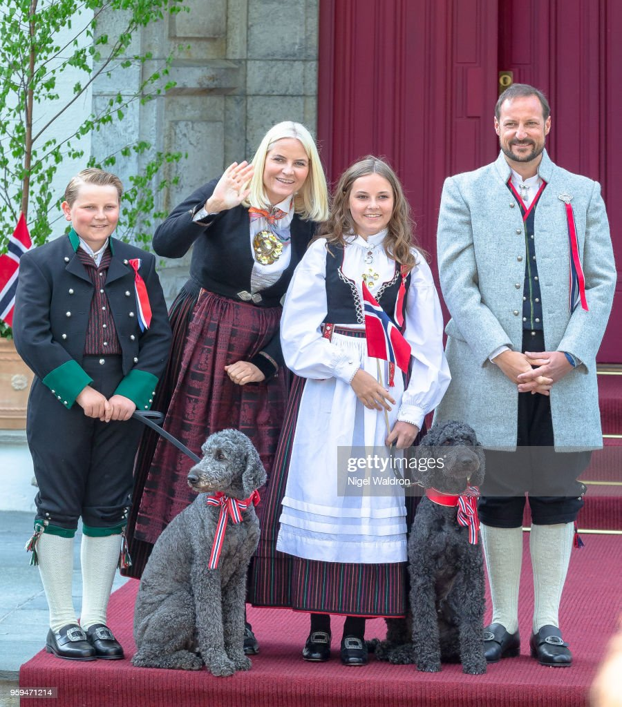 Prince Sverre Magnus of Norway, Princess Mette Marit of Norway and Princess Ingrid Alexandra of Norway, Prince Haakon Magnus of Norway outside their home at Skaugum Farm standing with their pet dog Muffins Krakebolle, Milly Kakao in Asker during Norway's National Day on May 17, 2018 in Oslo, Norway.