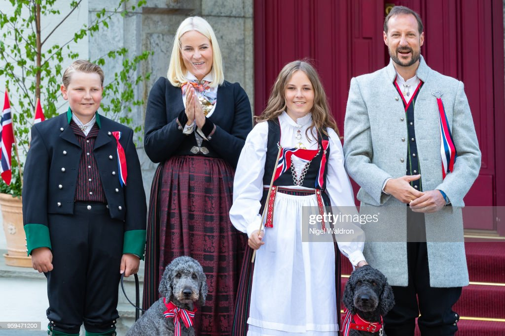 Prince Sverre Magnus of Norway, Princess Mette Marit of Norway, Princess Ingrid Alexandra of Norway and Prince Haakon Magnus of Norway wearing their national costumes during the childrens parade at Skaugum, Asker on Norway's National Day on May 17, 2018 in Oslo, Norway.