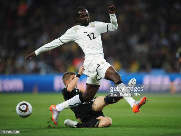 Prince Tagoe of Ghana is challenged by Bastian Schweinsteiger of Germany during the 2010 FIFA World Cup South Africa Group D match between Ghana and...