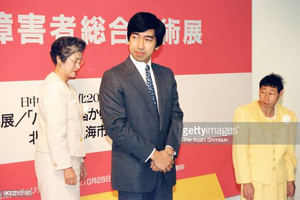Prince Takamado attends the opening ceremony of an art exhibition by disabled people at Seibu Department Store on October 28 1992 in Tokyo Japan