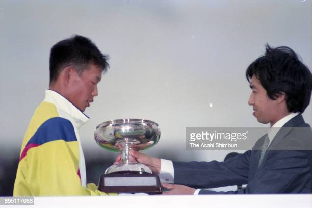 Prince Takamado presents the trophy to a representative of Kagawa Prefeture during the closing ceremony of the National Sports Festival at Naruto...