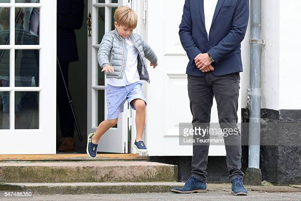 Prince Vincent of Denmark is being watched by security guards while he plays during the annual summer photo call for The Danish Royal Family at...