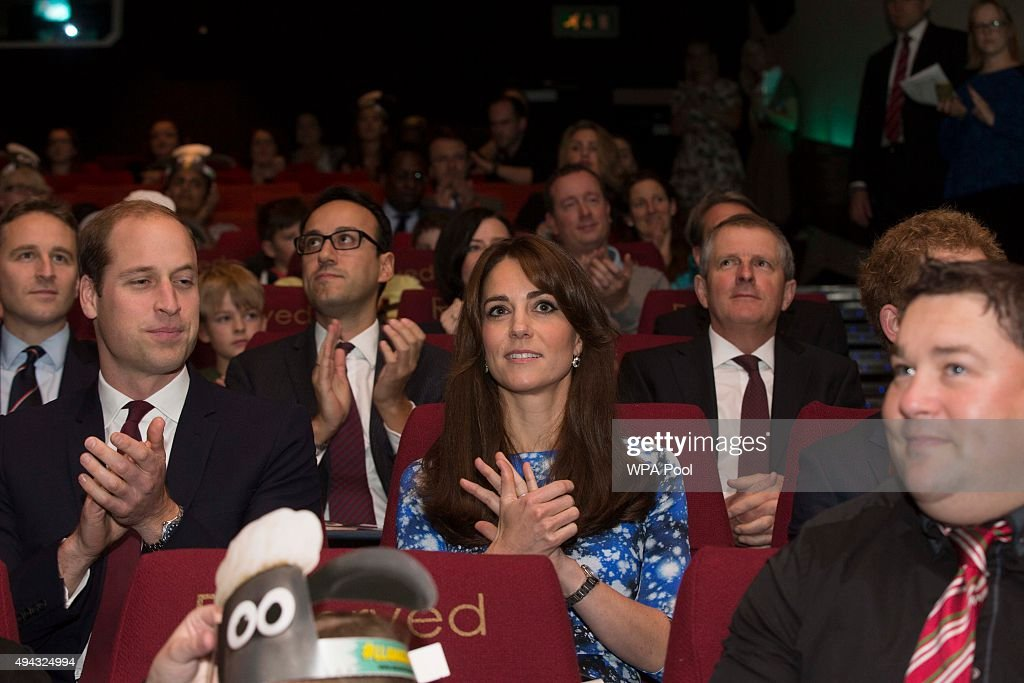 Prince Willam, Duke of Cambridge, Catherine, Duchess fo Cambridge and Prince Harry applaud with children and representatives from charities and Aardman Animations, during a meeting of the Charities Forum at BAFTA on October 26, 2015 in London, United Kingdom.