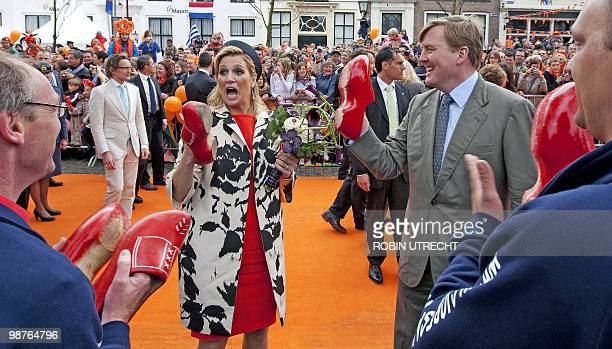 Prince Willem Alexander and Princess Maxima play a game with wooden clogs during the celebration of Queensday in Middelburg, on April 30, 2010. AFP...