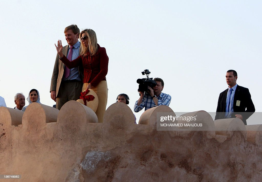 Prince Willem-Alexander looks on as and Princess Maxima waves during their visit to the Nakhal Fort, some 100 kms north of the capital Muscat, on January 11, 2012, along with Netherlands' Queen Beatrix (unseen) during her state visit to Oman.