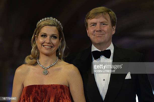 Prince WillemAlexander of the Netherlands and his wife Princess Maxima poses on April 29 2013 as they arrive to attend a dinner at the National...
