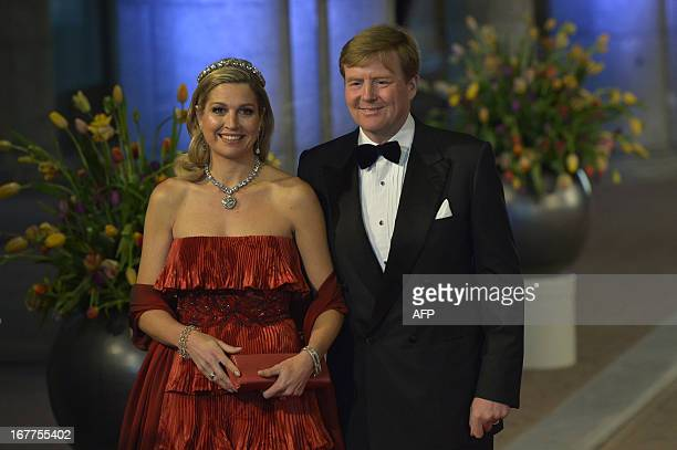Prince WillemAlexander of the Netherlands and his wife Princess Maxima pose on April 29 2013 as they arrive to attend a dinner at the National Museum...