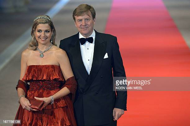 Prince WillemAlexander of the Netherlands and his wife Princess Maxima pose on April 29 2013 as they arrive to attend a dinner hosted by Queen...