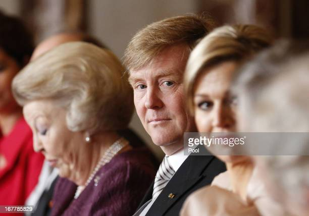 Prince WillemAlexander of the Netherlands sits alongside his mother Queen Beatrix of the Netherlands during her abdication ceremony in the Moseszaal...