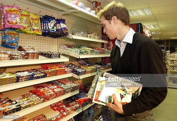 Prince William 12 December 2003 in the Good News newsagents in St Andrews showing that even Britain's most famous undergraduate resorts to a staple...