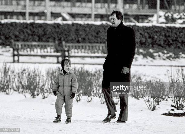 Prince William and a Royal Detective walk in the snow in a London Park on February 11 1986 in London United Kingdom