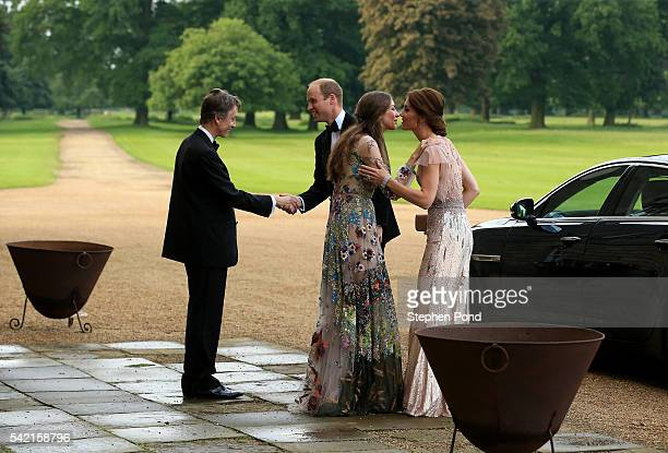 HRH Prince William and Catherine Duchess of Cambridge are greeted by David Cholmondeley Marquess of Cholmondeley and Rose Cholmondeley the...