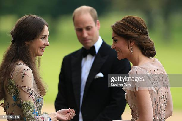 HRH Prince William and Catherine Duchess of Cambridge are greeted by Rose Cholmondeley the Marchioness of Cholmondeley as they attend a gala dinner...