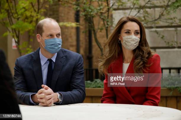 Prince William and Catherine Duchess of Cambridge meet pharmacist Joyce Duah as they visit St Bartholomew's Hospital in London to mark the launch of...