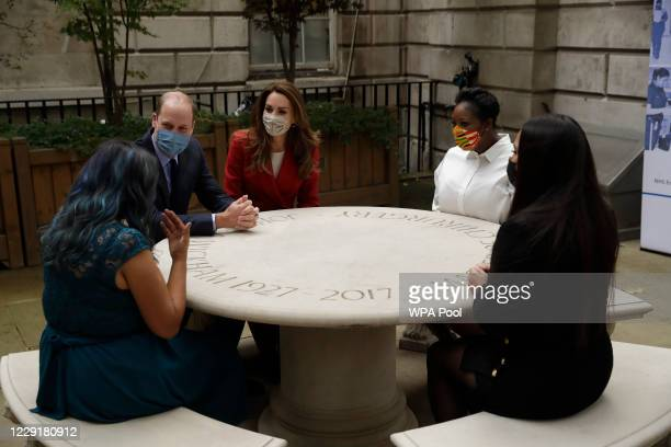 Prince William and Catherine Duchess of Cambridge meet pharmacist Joyce Duah second right and pharmacy technicians Amelia Chowdhury right and Dipal...