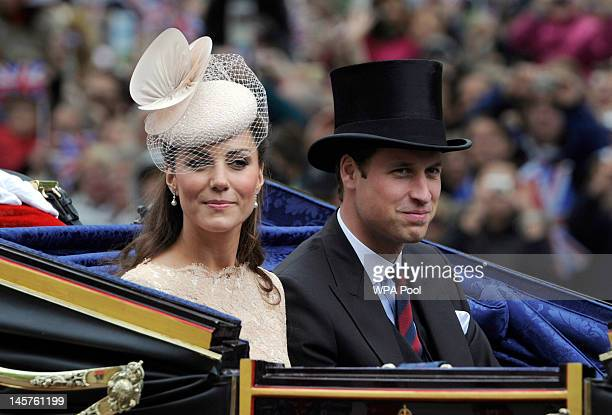 Prince William and Catherine Duchess of Cambridge pass along the mall after Diamond Jubilee service of thanksgiving at StPaul's Cathedral during the...