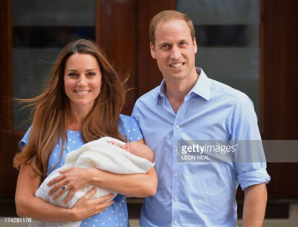 Prince William and Catherine, Duchess of Cambridge show their new-born baby boy to the world's media, standing on the steps outside the Lindo Wing of...