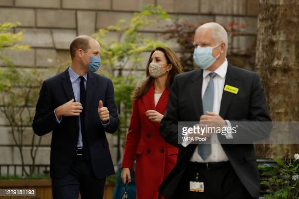 Prince William and Catherine Duchess of Cambridge walk with Professor Charles Knight the chief executive of St Bartholomew's Hospital in London as...