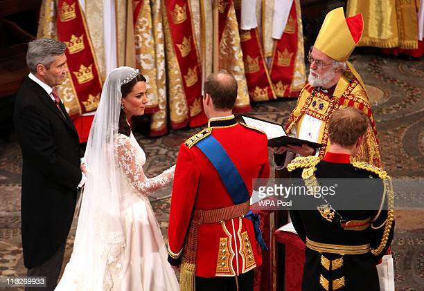 Prince William and Catherine Middleton are seen at the altar with Archbishop of Canterbury Rowan Williams Prince Harry and father of the bride...